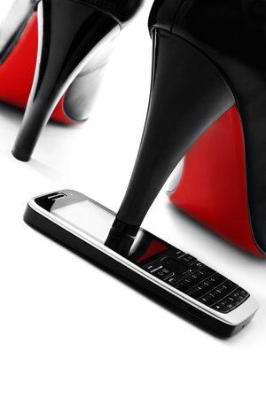 High heel shoe on cellphone