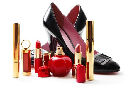 make up products: Lady shoes and cosmetics isolated on white Stock Photo