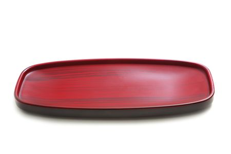 black dish: Red dish isolated on white
