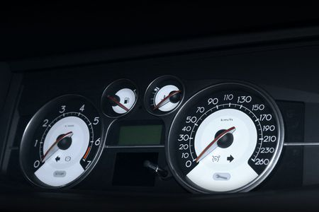 Dashboard of a car with speedometer photo