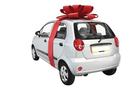 Car with bow isolated on a white background photo