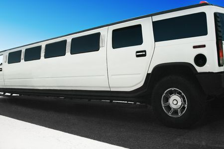 hummer: White limousine on the road Stock Photo