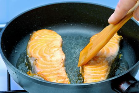 Fillet trout in a frying pan photo