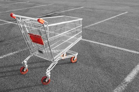 Shopping cart in a store parking lot photo
