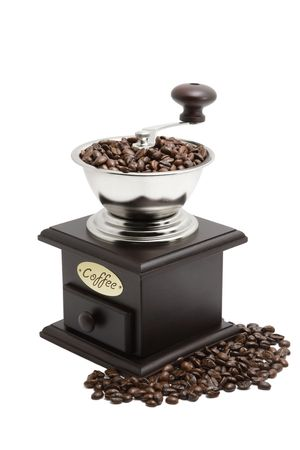 Coffee grinder with coffee beans isolated over white photo
