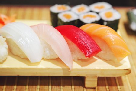 Sushi on a wooden plate Stock Photo - 6624070