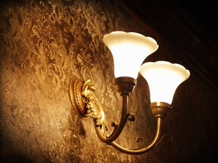 Old lamp on the wall photo