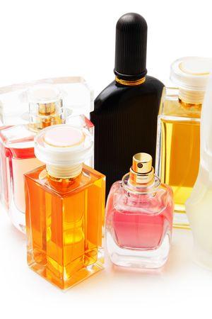 gauzy: Perfume bottles isolated on white