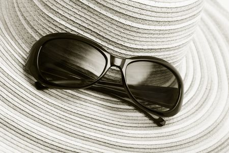 tinted glasses: Straw hat and sunglasses Stock Photo