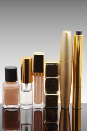 Cosmetics isolated on a grey background photo
