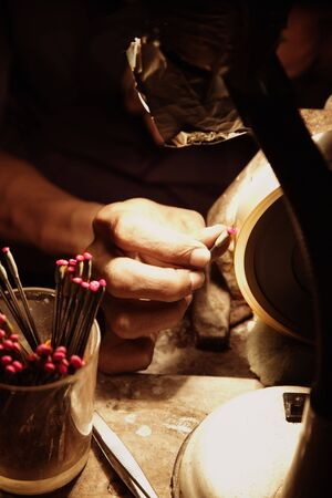 etch: Jeweller polishing a ruby jewel