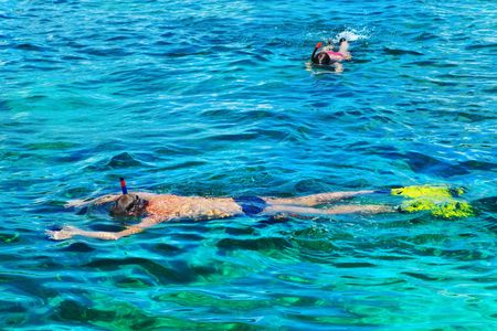 People snorkeling in the sea photo