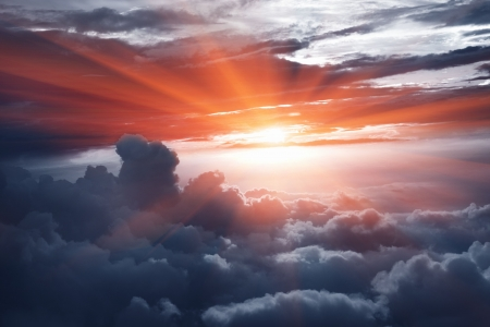 high rises: Sunset above the clouds Stock Photo