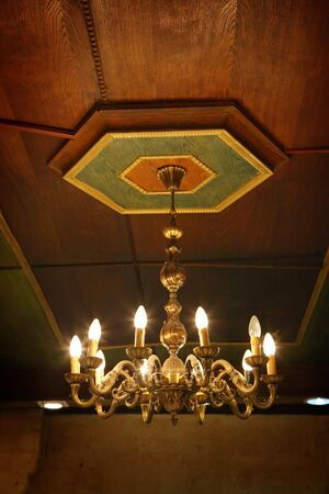 Old electric chandelier lamp on ceiling Stock Photo - 6823812