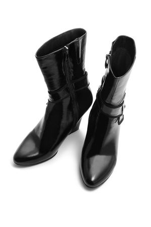 Black boots isolated on white photo