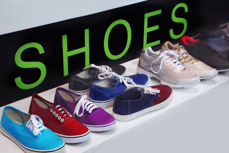 Lots of sneakers shoes on sale Stock Photo - 9635950