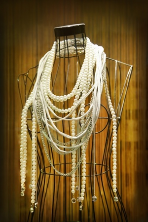 pearl necklace: Mannequin with necklaces in store showcase