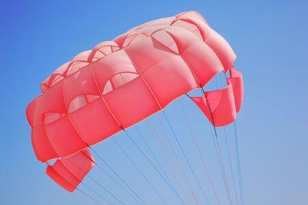 parasailing: Close up of pink parasailing