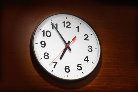 timing: Clock on the wooden wall