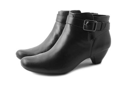 Black boots isolated on white background photo