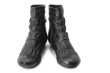 feet soles: Black boots isolated on white Stock Photo