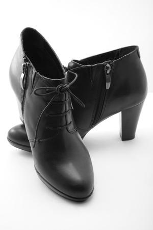 Black boots on white background photo