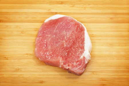 Raw pork chops on a cutting board Stock Photo - 12284755