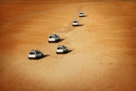 Jeeps driving in the Sahara desert photo