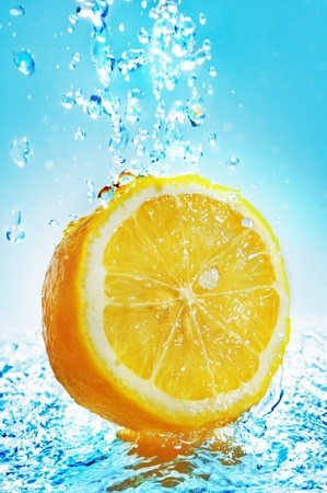 Water splash on lemon photo