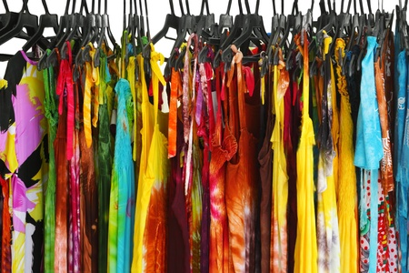 yellow dress: A row of summer clothes hanging on the rack