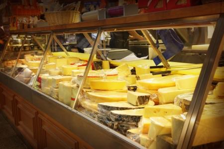 A diferencia de queso en una tienda photo