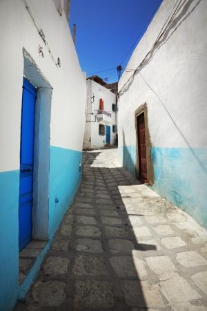 A narrow street in Sousse, Tunisia photo