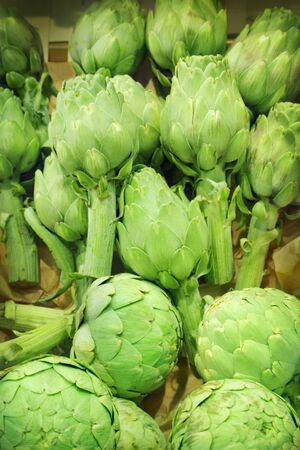 Stacked artichoke in the market photo