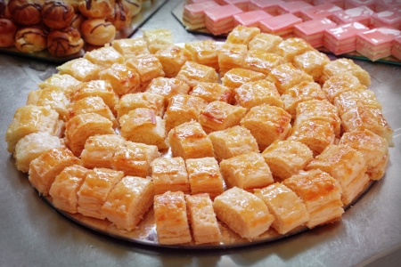custard slices: Cakes and pastries served on a tray Stock Photo