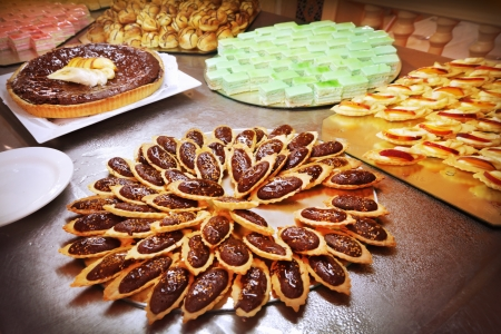 Cakes and pastries served on a tray photo