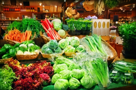 grocer: Vegetables at a market stall
