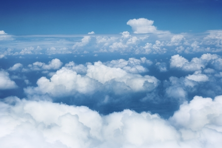 Sky and clouds from flying airplane Stock Photo