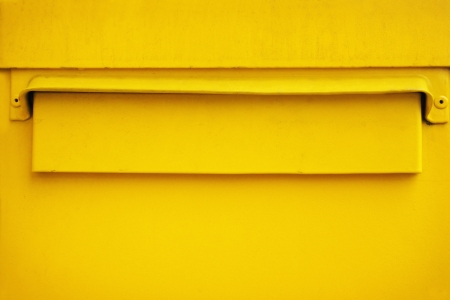 Closeup of yellow mail box