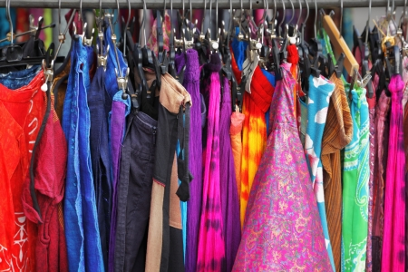 woman closet: A row of clothes hanging on the rack Stock Photo