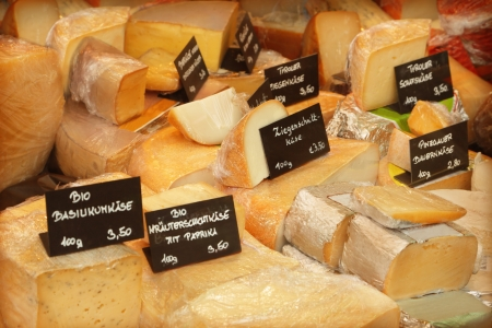 Different cheeses in a shop photo