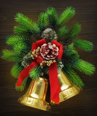 Christmas bells with red ribbon and pine twigs photo