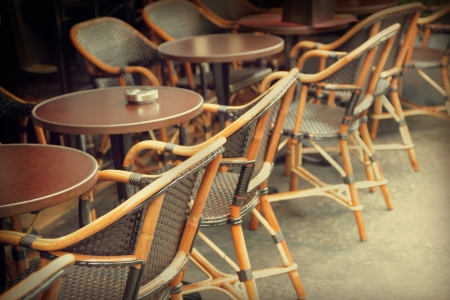 seating furniture: Typical outdoor cafe in Paris Stock Photo