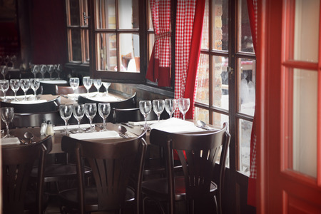 parisian: Traditional restaurant interior with tables and chairs