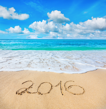 beach resort: 2016 written on sandy beach