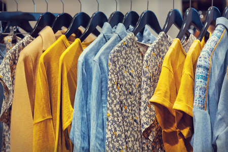 A row of clothes hanging on the rack Stock Photo