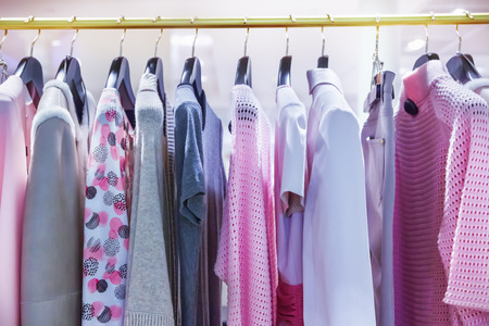 female clothing: A row of clothes hanging on the rack Stock Photo