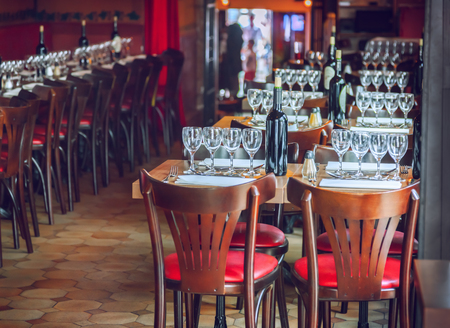 Traditional restaurant interior with tables and chairs