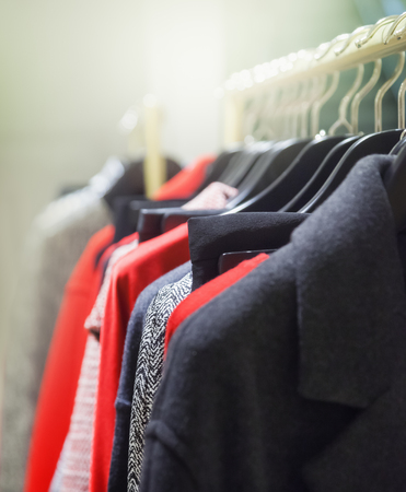 clothing store: A row of clothes hanging on the rack Stock Photo