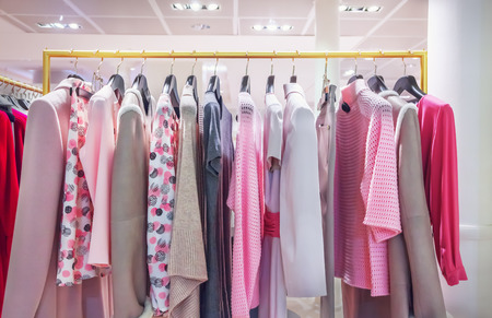 clothes hanging: A row of clothes hanging on the rack Stock Photo