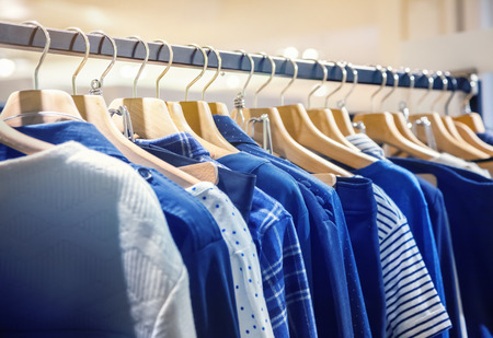 clothing rack: A row of clothes hanging on the rack Stock Photo